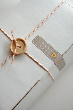 Love the button, bakers twine and the little sticker label that looks stitched that says handmade.