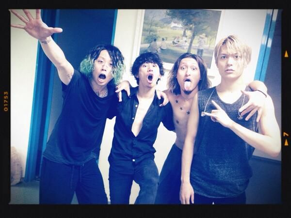 """In concert, Taka said """"I'm a shy boy!"""" and refused to open his shirt. But he has an open shirt in this photo!! :o"""