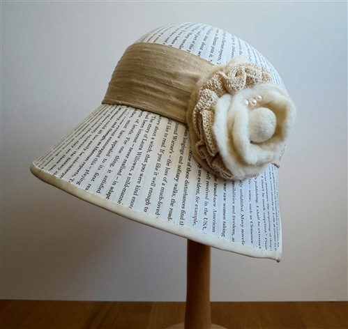 Annie Ward  She Wears it Well 5, 2012  Paper cloche hat created from fabriano book paper printed with downloaded text from Sylvia Townsend Warner's book 'Lolly Willowes'. Part of a paper hat installation commemorating various women authors.  Sylvia Townsend Warner called for 'a life of one's own', three years before Virginia Woolf made a similar plea.: Book Art, Hat Created, Book Fashion, Book Lolly, Cloche Hats, Fabriano Book, Paper Hats, Book Paper