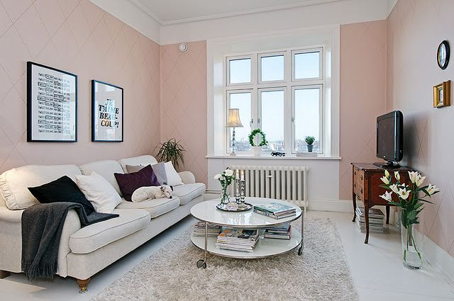 There's not many pink rooms that are done well. The pattern on the walls brings depth to the pink.