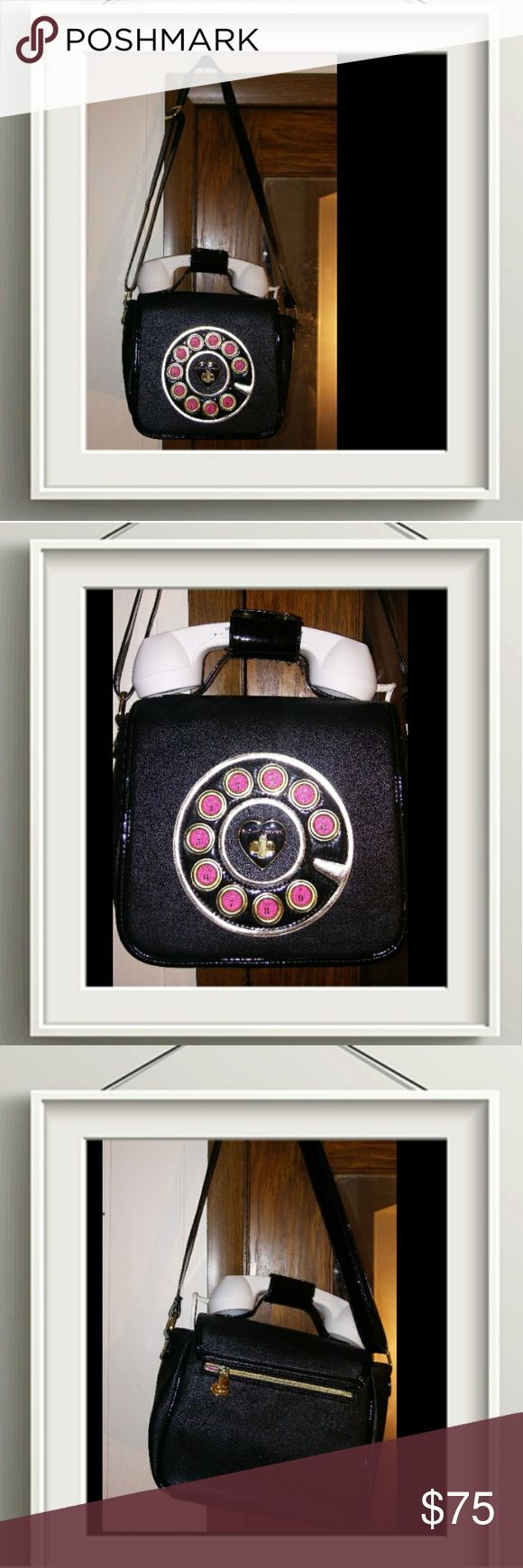 ✴New✴Black /white Betsey Johnson phone purse ✴New✴ without tags cute black /white Betsey Johnson phone purse with a white phone receiver that really works it can plug into any cell phone ! the interior of the purse has this pretty pink roses material.Reasonable offers considered. Betsey Johnson Bags Shoulder Bags