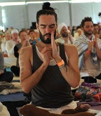 russell brand doing yoga.