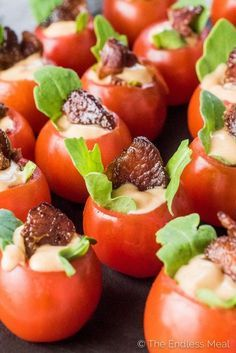 If you're looking for bite-sized appetizers for your next party, look no further. These Mini BLT Cups are as cute as they are delicious! Cherry tomatoes are stuffed with arugula and a little chipotle mayo then topped with a piece of crunchy bacon. They're a healthy gluten-free + paleo + Whole30 appetizer recipe that everyone will love! | theendlessmeal.com | #appetizer #partyfood #blt #thanksgivingappetizers #christmasrecipes #tailgating #paleo #whole30 #healthyrecipes