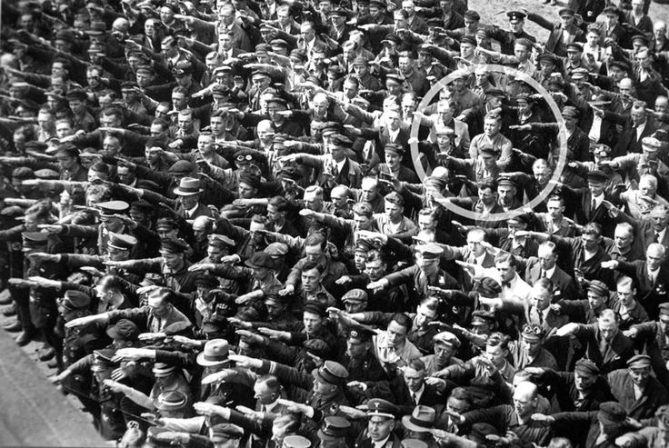 The man who didnt salute Hitler. 1936. The story of August Landmasser is amazing as it is tragic. Landmasser fell in love with a Jewish woman who, before they could marry, was sent to a concentration camp. Before he would be sent to a labor camp, this picture captured Landmasser refusing to partake in the Nazi salute during a public rally in 1936. He died in a Nazi death camp.
