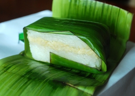 Lemper, steamed sticky rice with shredded chicken filling, wrapped in banana leaf, usually served as snack on tradisional party.