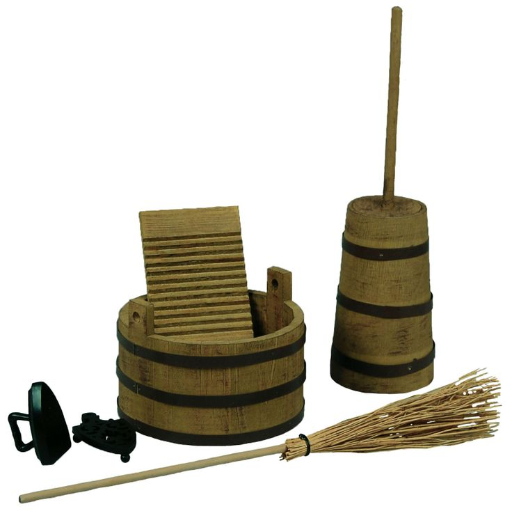 """This Little House on the Prairie® set features a 5 piece 18"""" doll historic """"housekeeping"""" collection including a wooden washtub, washboard, butter churn, bristle broom, iron and matching trivet stand."""