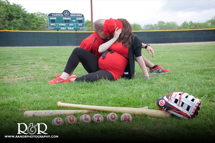 Baseball Maternity Photography | Black and Red | Parents Kissing