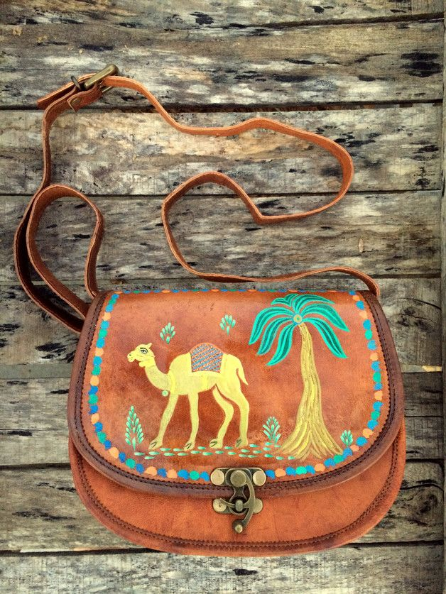 Stunning handmade light brown / tan leather saddle cross body bag  Front buckle latch closure Purse has 2 pockets w/snap button closure Lined w/2 zip pockets, 2 slip pockets  PLEASE SEE...