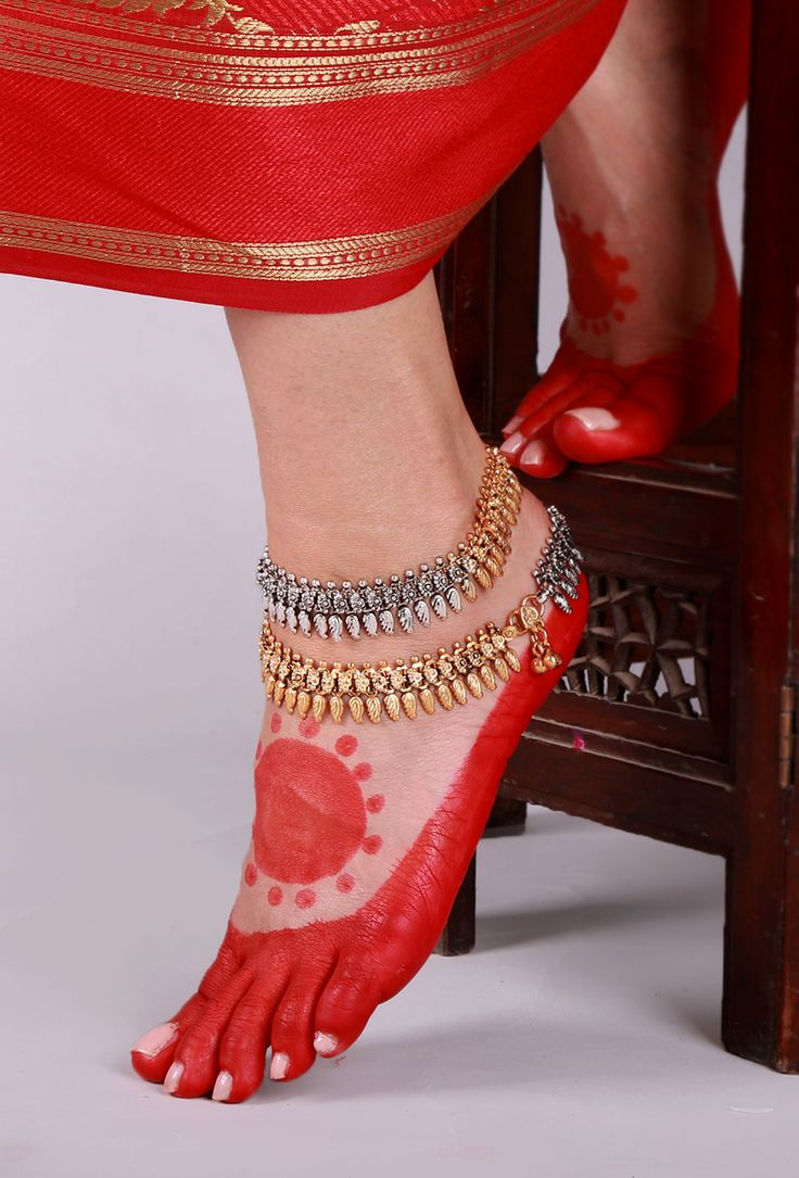 Dual Tone Lambani Anklet Traditionally, the Lambani women folk wear jewelry made out of copper, white metal and silver. Trying to revive the traditional lambani jewelry we have curated a collection of 22 carat gold and silver plated anklets.