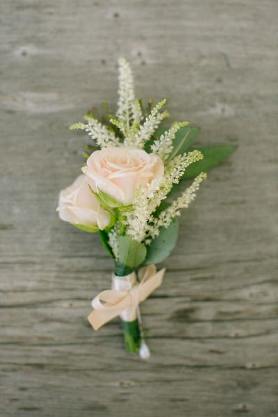 Can easily substitute a white sweetheart rose or ranunculus instead of the soft pink rose pictures here.  Soft pink rose boutonniere: http://www.stylemepretty.com/california-weddings/2015/02/16/rustic-summer-wedding-at-circle-oak-ranch/ | Photography: Heidi-o-photo - http://heidiophoto.com/