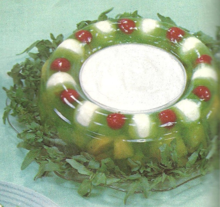 Ew - balls of cream cheese embedded in that jello ring.  Also contains ginger ale in the middle, mixed with sour cream.