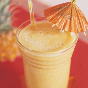 Tropical Mango Smoothie    A tropical paradise in a glass, this mango smoothie should be made with firm, ripe bananas and perfectly ripe mangos for best flavor.