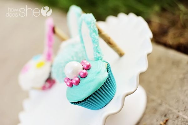 High-heel cupcakes.  Wonder if you could use a Milano cookie for the arch instead of a graham cracker?