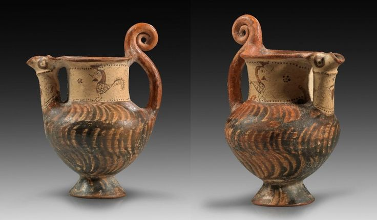 Lydian jug with spiral-handle, 7th century B.C. The spout is painted with eyes and beak and resembles a bird´s head. On the neck two birds, and on the corpus the characteristic lydian decor made of dark brown, curved lines, 17.6 cm high. Private collection
