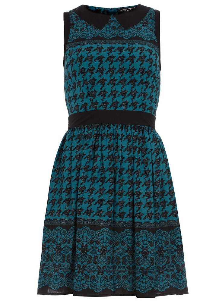 This teal sleeveless prom dress mixes the classic dogtooth print with a feminine lace print. The solid black collar, waistband and edging provide pretty accents. The black bow at the waistband also helps to give a flattering silhouette - would look lovely with opaque tights and classic black pumps.  Wearing length 96 cms. 100% Polyester. Machine washable.