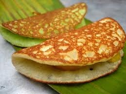 Apom, apong or pancake is a delicious savoury that can be enjoyed in between meal times. It is made with a batter of flour and eggs with banana slices and corn added while it is cooking.