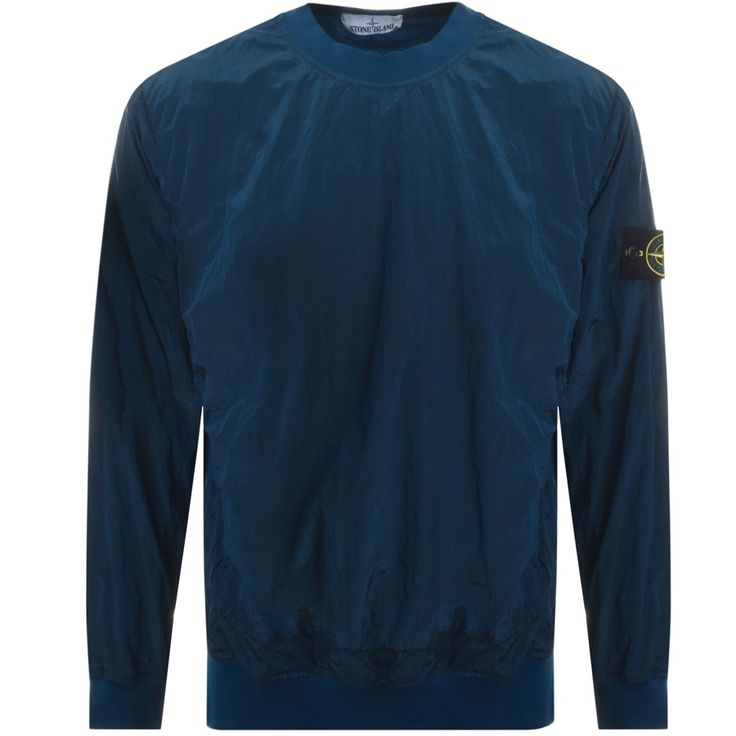 Stone Island Crew Neck Sweatshirt Jumper In Dark Blue, A synthetic sweatshirt with an overall crinkle effect and a high shine colour. A ribbed jersey crew neckline with ribbed cuffs on the long sleeves and a stretch ribbed waistband. Two zip fastening pockets at the waist with a zip fastening on the left side seam. The signature removable embroidered Stone Island Compass Rose logo badge is situated on the upper left sleeve in black, yellow and green. A full mesh lining. 100% Polyamide. Brand…