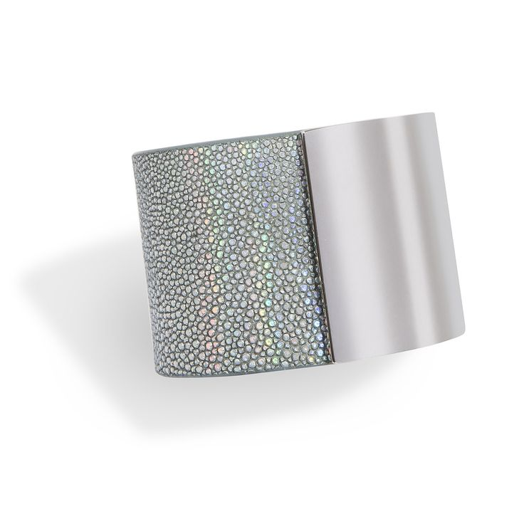 Momentum, a cuff bracelet in  silver shagreen and titan-plated brass, hand crafted in a sleek and sophisticated design is the signature piece of De Galluchat.  #treasurethemoment #momentum #cuff #shagreen #degalluchat #galuchat #titan