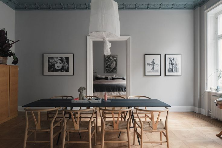 This Swedish apartment is full of character and the dining room with Wishbone chairs around a large table is right at the centre. Great use of plants and artwork throughout.