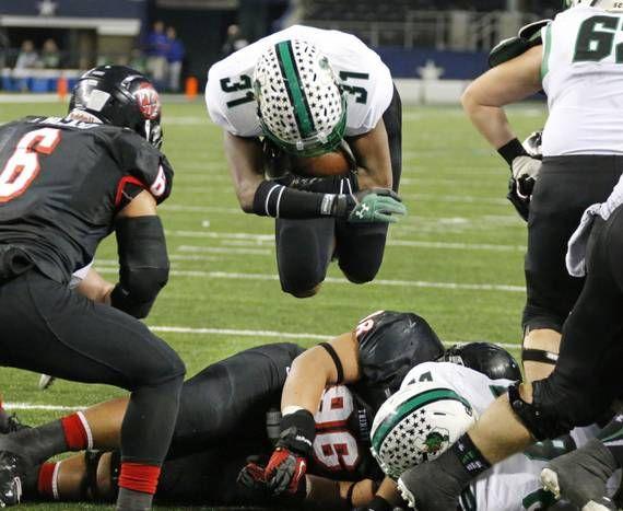 Carroll running back Lil' Jordan Humphrey (31) goes airborne to score a third quarter touchdown during the Euless Trinity High School Trojan...