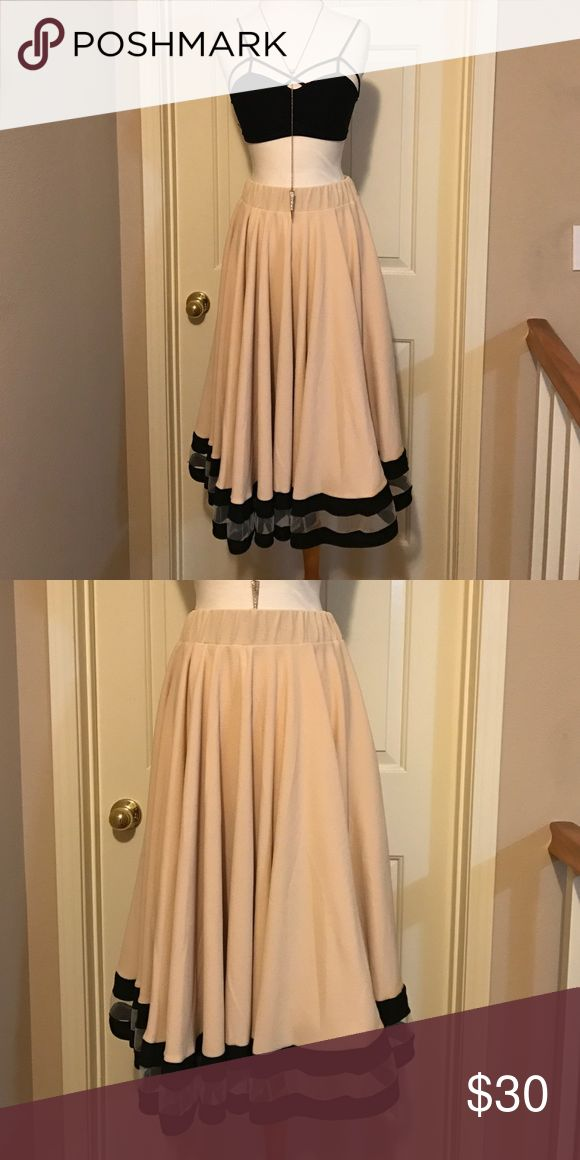 Midi Skirt with Sheer Panel Shirt has Sheer Net and cotton on the bottom. Fabric is thick very forgiving.- meaning has lots of stretch. Elastic Waist Band . Would look great with a blazer.  85% Polyester 15% Spandex Skirts Midi
