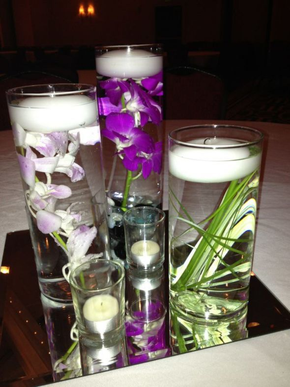 My purple orchids center piece with bear grass loved it