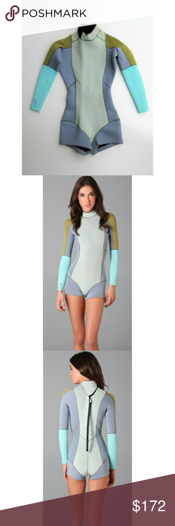 Color Block Spring Wetsuit 2/30 NWT This fiber-lite neoprene wetsuit features contrast topstitching at the bonded, color block nylon panels. Velcro® closure at collar. Hidden zip closure and hidden zip pocket at back. Long sleeves. Glued and back stitched (GBS) seams - New with Tags - Film Set Wardrobe - Never Worn - Minor Signs of Handling (Creasing/ Dust) Nothing Notable  - Visit RubyandSofia.com for more info -  Chest - 16 +/- Hips -13.25 Length -2.5 / 28 Short Inseam / Back of Neck to…