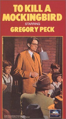 How is the theme of ignorance developed in Harper Lee's To Kill a Mockingbird?