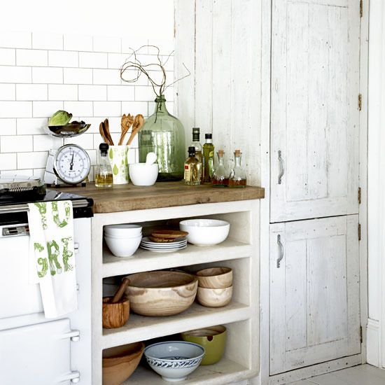 (We keep our cabinet doors off too!) : Rustic kitchen storage  Distressed furniture is the perfect way to add a vintage, rustic feel to a white kitchen, instantly giving it character. Keeping oils, vinegars and blending bowls together on display on open shelves completes the look.