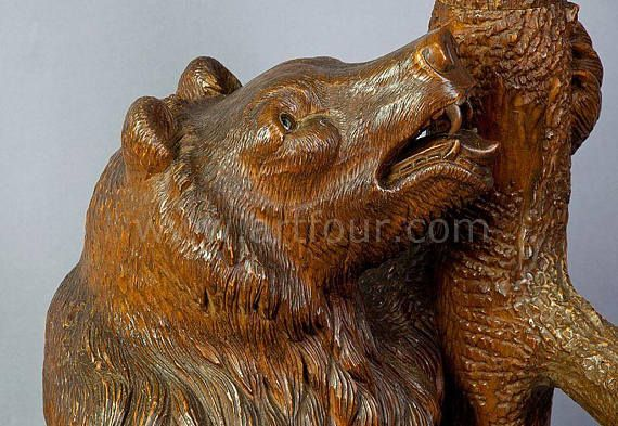 a handcarved wood bear hallstand. the mother bear looking upwards at her cub hanging in the branches. executed ca. 1900, swiss brienz. height: 82,68 inches, shipping information please send us your destination (country and zip code) an well calculate shipping to your location.