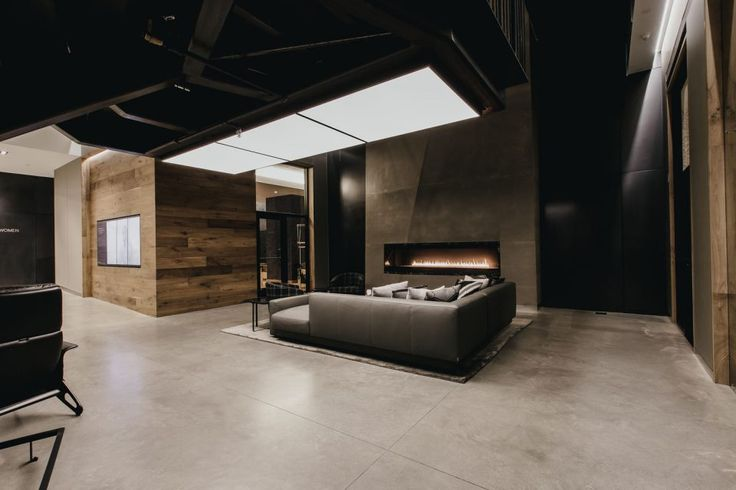 Fireplace and lounge with overhead lighting