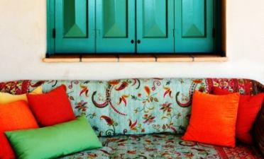 Greek interior designs - colorful sofa throw with bright cushions
