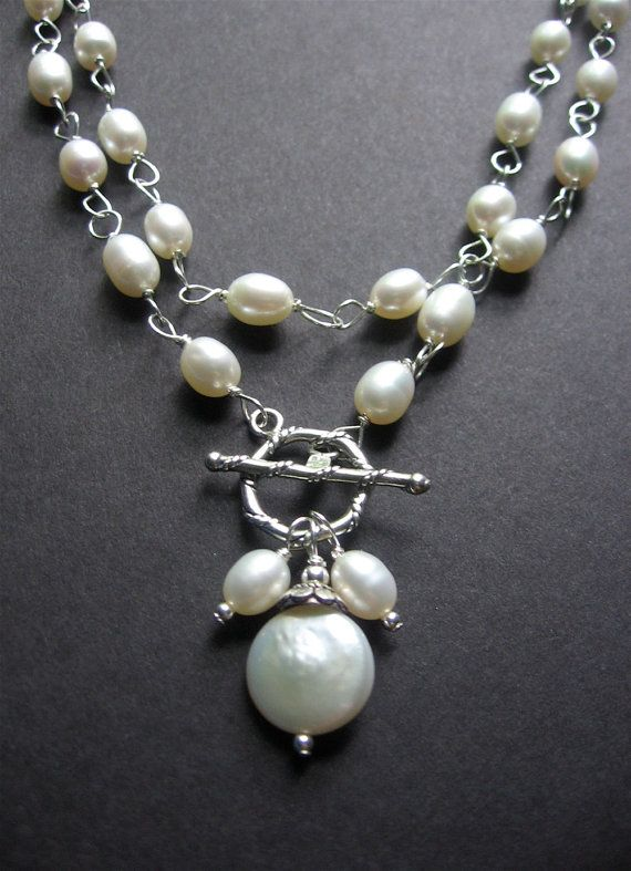 Long Pearl Statement Necklace. Long Pearl Wire Wrapped Necklace. Bridal Jewelry - Grace Necklace    A long pearl necklace that is versatile. I think it would look great with so many items.    White freshwater pearls have been wire wrapped together using sterling silver wire. The necklace is 34 inches in length and closes with a sterling silver toggle. Dancing from the toggle are two smaller freshwater pearls and a large coin pearl. The pearls have been paired with sterling silver to add an…