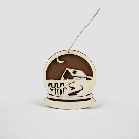 Wooden snow globe Christmas ornament with a house.