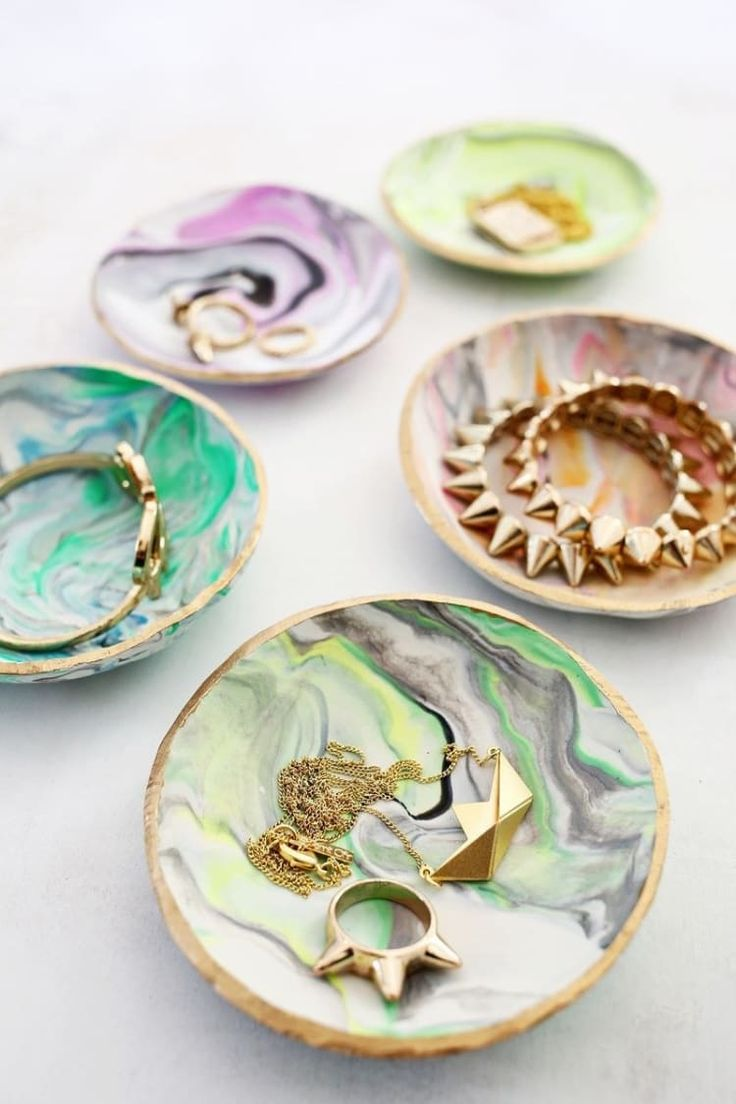 Marble together various colors for bright gifts that guests will love. You can also buy cute bridal-themed ring dishes here. And get the tutorial here.