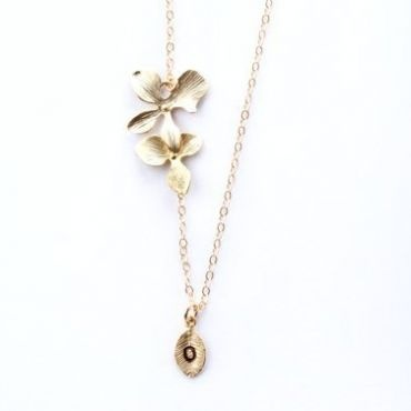 This delicate trio orchid necklace will add elegance to any dress.    The length of drop portion can be adjustable by simply moving trio orchid up or down. The leaf is custom made with any initial of your choice.    The chain and findings are sterling silver and with white gold plated orchids. $59