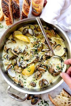 Small, sweet clams are cooked in a garlicky white wine and cream sauce to create the best sauce for sourdough bread dipping.