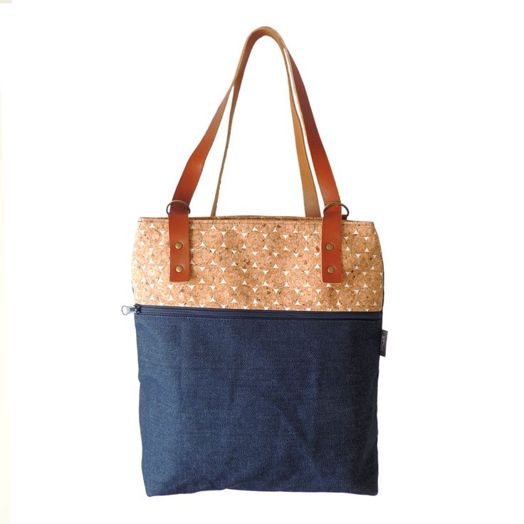 """Cork and Denim Bootie Pack :: The perfect bag for traveling or a jaunt around town, the Bootie Pack transforms from sleek backpack into a tote! DIMENSIONS: 12.75""""W (at zipper) x 12.75""""T x 5"""" D Made in San Francisco"""