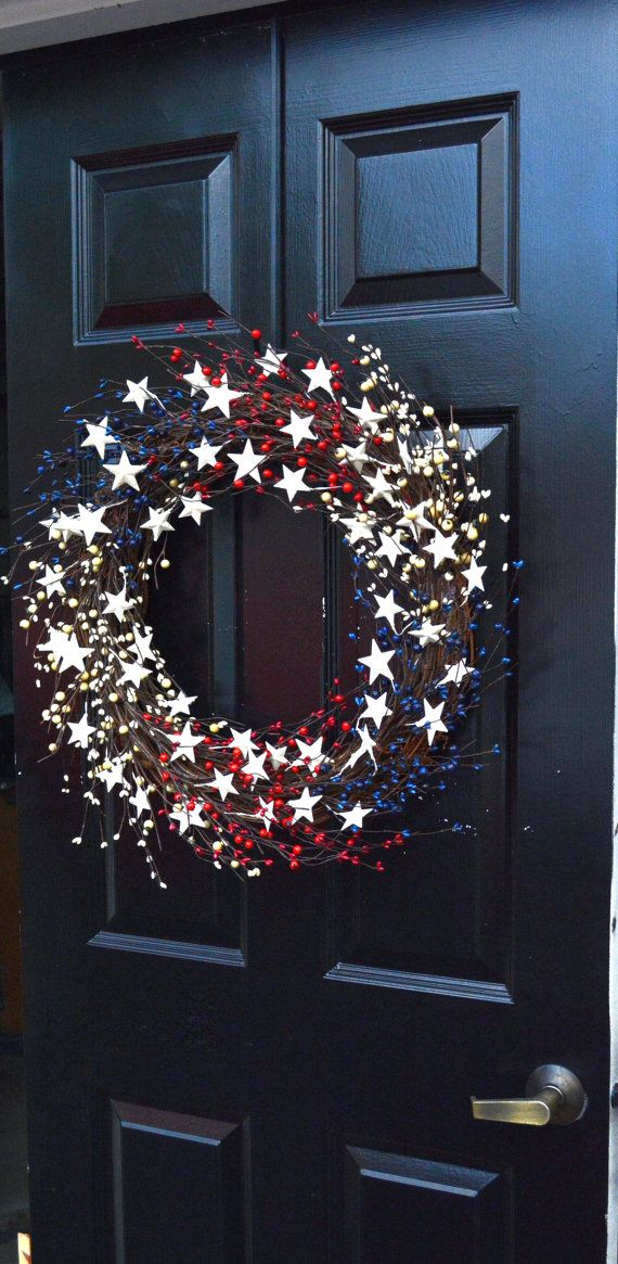 Show your patriotic spirit with this beautiful red, white and blue berry wreath accented off white metal stars. Double the berries as my smaller 18