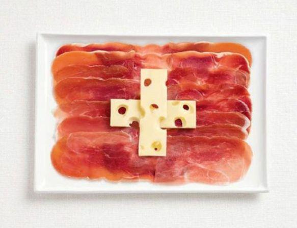 Croce coi buchi svizzeri Prosciutto crudo per il rosso che fa da sfondo alla croce greca bianca che sta al centro: è emmental svizzero.  WHYBIN TBWA via Focus