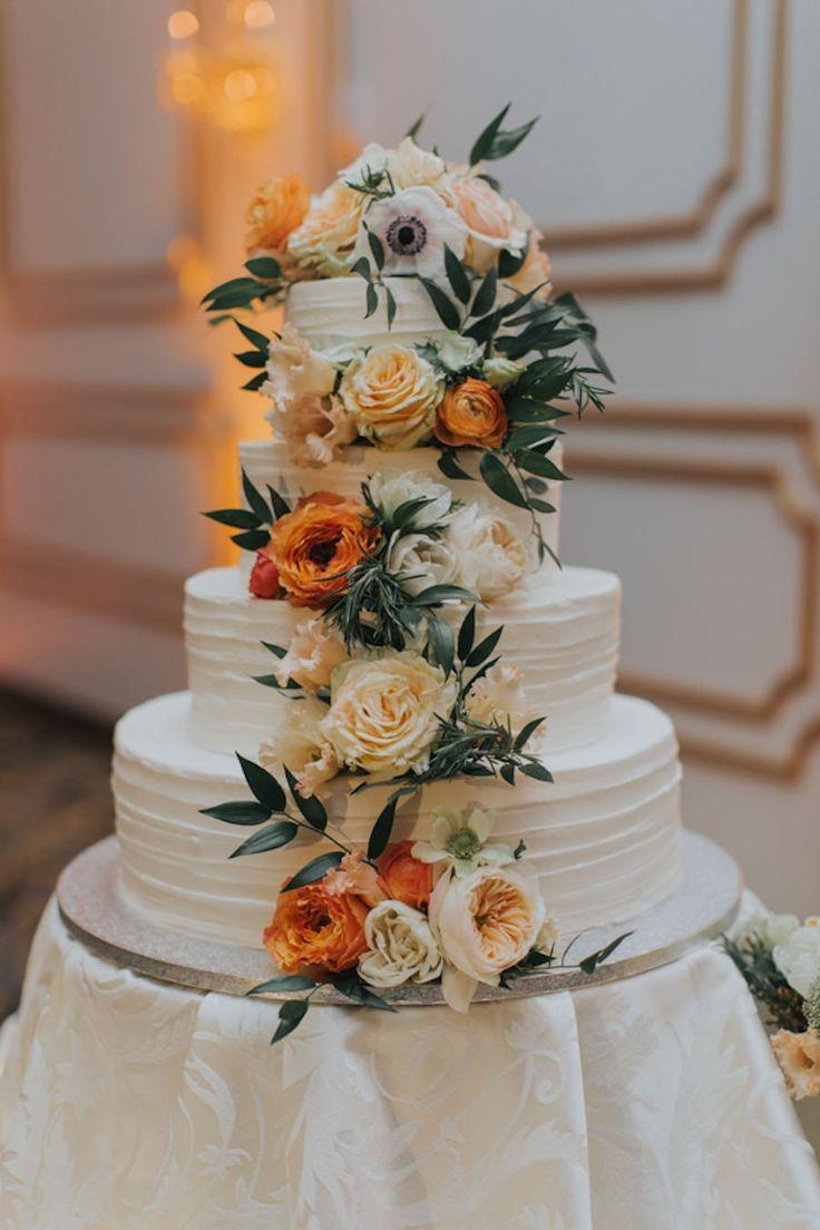 4 Tiered, Round, White Wedding Cake with Cascading Orange and Ivory Flowers with Greenery  Wedding Cake | Tampa Weddings | Florida Weddings | Epicurean Hotel