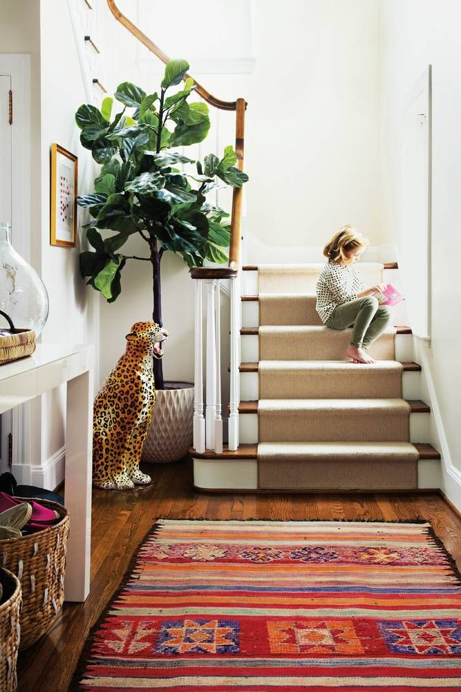 quirky statement leopard statue, fig tree plant, and Persian rug...eclectic décor