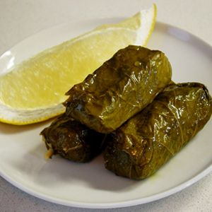 Dolmathes recipe from the Salt Lake City Greek Festival.  Best I have ever had.  I think its the sauce because everyone else uses a  tzatzkiki sauce.