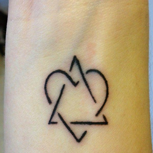 new tattoo adoption symbol representing love