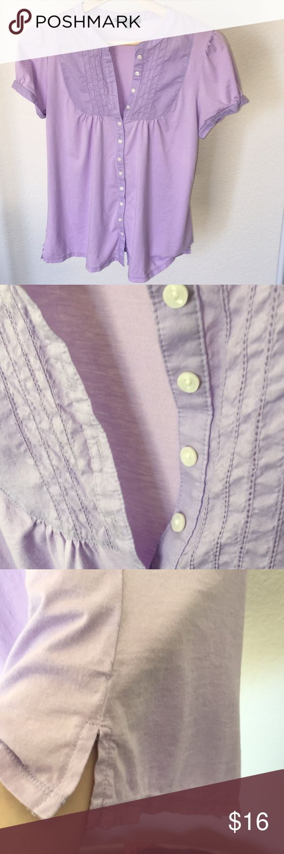 Gap short sleeve lilac button down Light lilac, short sleeve button down top by Gap. Fitted with buttons on the sleeves.  Hem is slitted at the sides.  Body:  60% Pima cotton, 40% modal. Yoke/trim:  100% cotton. GAP Tops Button Down Shirts