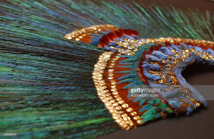 A detail view of the Penacho feather headdress allegedly worn by Aztec emperor Moctezuma II is displayed at the Museum fur Volkerkunde (Museum of Ethnology) in Vienna on November 16, 2012. Some say it was brought to Europe by Spanish conquistador Hernan Cortes, others that it was used by an Aztec high priest. In any case the flaming green-and-blue headpiece -- the only one of its kind still in existence -- remains at the centre of a tug-of-war between Mexico, which would like to bring it…