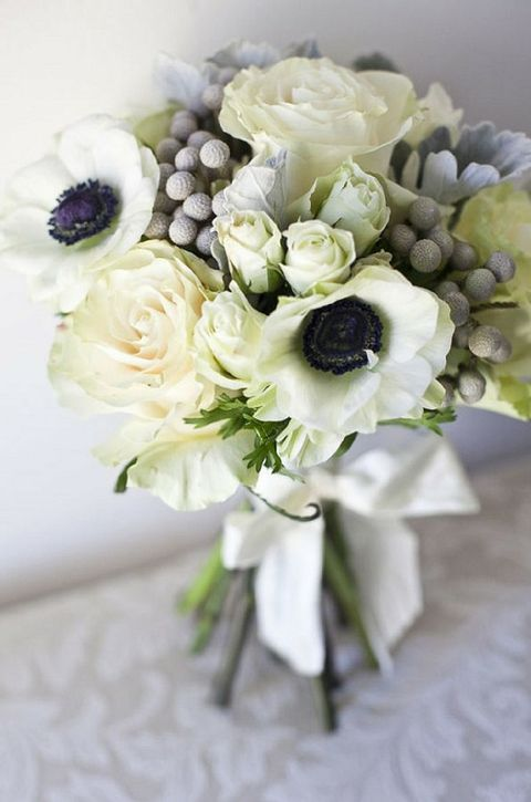 white bouquet with pops of black from gorgeous anemones, texture from garden and spray roses, and pretty silver hues from silver brunia berries and velvety dusty milller leaves
