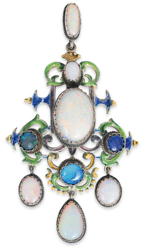 An opal pendant  Silver. Pendant made in Renaissance style. With enamel, 6 opals and probably 3 opal-tripletts.
