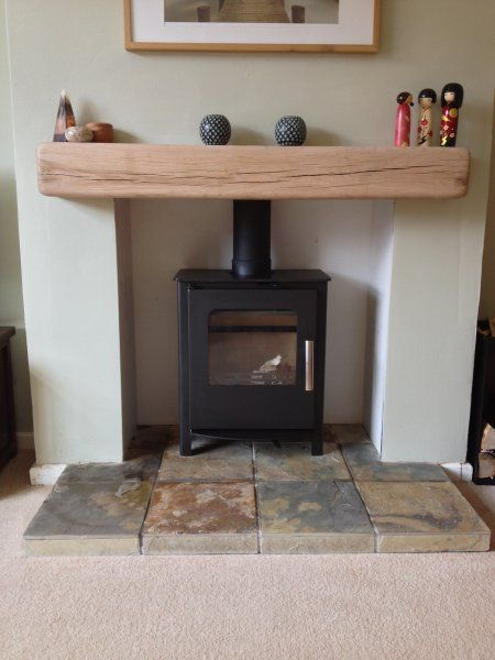 Mendip Loxton multifuel DEFRA approved stove, barley slate hearth and solid oak beam