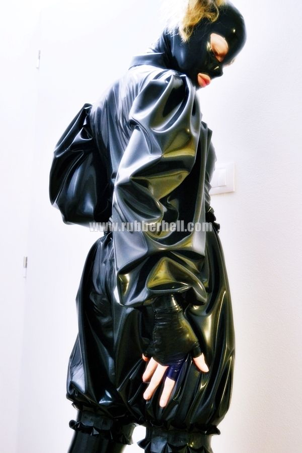 It's hot, temperature was almost at 35 C and I'm standing in my rubber room. It's full of clothes and I'm eager to choose something loose. I want to add a second layer to my catsuit, so I choose latex shirt with long sleeves and loose shorts..... I'm dressed from head to toe, and it is fantastic. It's gonna be hot evening ..... More at: www.rubberhell.com
